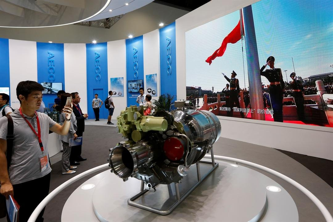 """Visitors look at aircraft parts on display at Aviation Expo China in Beijing. China on April 4, 2018 vowed to take measures of the """"same strength"""" in response to a proposed U.S. tariff hike on $50 billion worth of Chinese goods (AP Photo/Andy Wong)"""