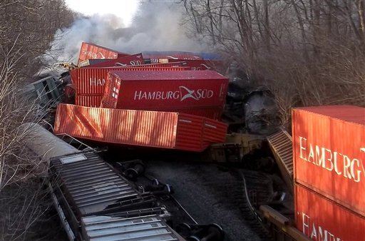 Smoke pours off derailed cars following a train derailment, Friday, Jan. 6, 2012 near Valparaiso, Ind. (AP Photo/The Post-Tribune, Jimmy Herrick)