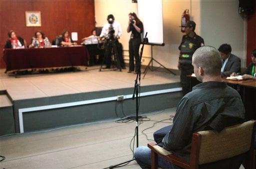 Joran Van der Sloot, right, attends his murder trial held at the San Jorge prison in Lima, Peru, Friday Jan. 6, 2012. (AP Photo/Karel Navarro)