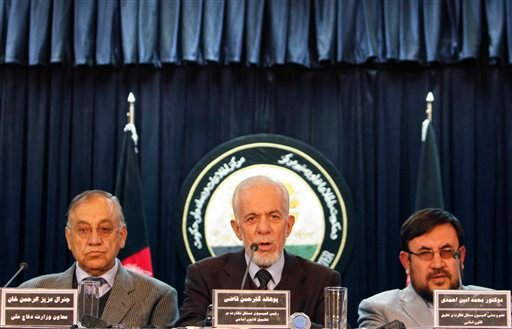 Gul Rahman Qazi , center, head of an Afghan investigative commission speaks during a media conference in Kabul, Afghanistan, Saturday, Jan. 7, 2012. (AP)