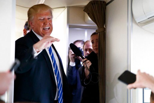 President Donald Trump talks with reporters aboard Air Force One on a flight to Andrews Air Force Base, Md., Thursday, April 5, 2018. (AP Photo/Evan Vucci)