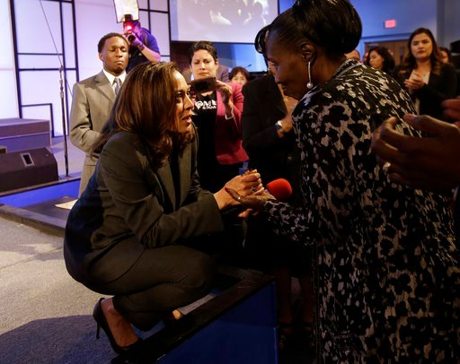 U.S. Sen. Kamala Harris, D-Calif., left, talks with Sequita Thompson, the grandmother of Stephon Clark, who was shot and killed by Sacramento police, during a town hall meeting Thursday, April 5, 2018, in Sacramento, Calif.