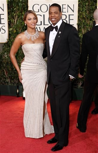 FILE - In this Jan. 11, 2009 file photo, Beyonce, left, is joined by husband Jay-Z, as she arrives at the 66th Annual Golden Globe Awards in Beverly Hills, Calif.