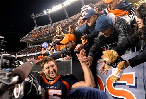Denver Broncos quarterback Tim Tebow greets fans after the Broncos beat the Pittsburgh Steelers 29-23 in overtime of an NFL football wild card playoff game Sunday, Jan. 8, 2012, in Denver. (AP Photo/The Denver Post, Joe Amon)