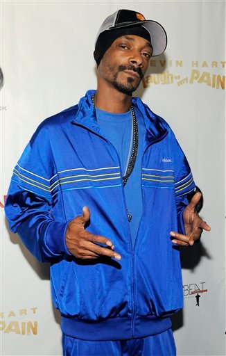 "FILE - In this Sept. 7, 2011 file photo, rapper Snoop Dogg poses at the premiere of the film ""Laugh at My Pain"" in Los Angeles."