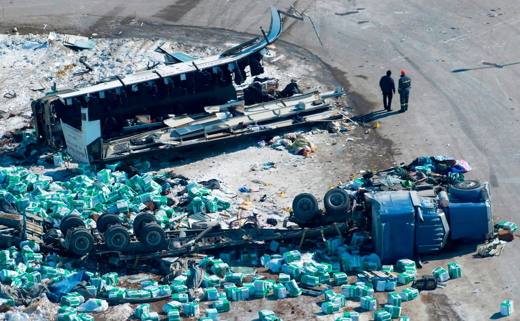 The wreckage of a fatal crash outside of Tisdale, Sask., is seen Saturday, April, 7, 2018. (Jonathan Hayward/The Canadian Press via AP)