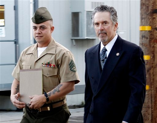 FILE - In this Jan. 5, 2012 file photo, United States Marine Staff Sgt. Frank Wuterich arrives at a court room at Camp Pendleton with lead defense attorney Neal Puckett in Camp Pendeton, Calif. (AP Photo/Lenny Ignelzi, File)