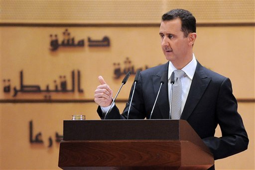 In this photo released by the Syrian official news agency SANA, Syrian President Bashar Assad delivers a speech at Damascus University, in Damascus, Syria, Tuesday, Jan. 10, 2012. (AP Photo/SANA)