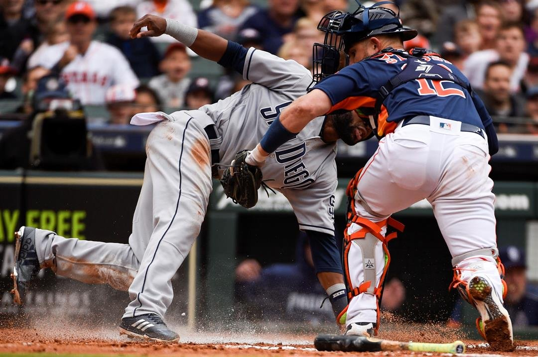 Houston Astros catcher Max Stassi, right, tags out San Diego Padres' Manuel Margot at home during the fifth inning of a baseball game, Sunday, April 8, 2018, in Houston. (AP Photo/Eric Christian Smith)
