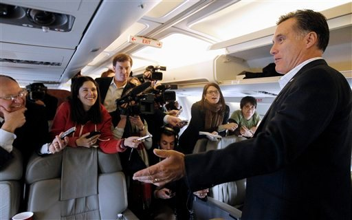 Republican presidential candidate, former Massachusetts Gov. Mitt Romney talks to reporters on his campaign charter plane in Bedford, Mass., Wednesday, Jan. 11, 2012. (AP Photo/Charles Dharapak)
