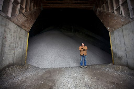 Jeff Gould, lead equipment operator for the Department of Public Works in Sioux Falls, S.D., stands in front of a giant salt dome filled with rock salt Wednesday, Jan. 11, 2012. (AP Photo/Amber Hunt)