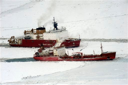 In this Jan. 7, 2011 photo provided by the U.S. Coast Guard, the Coast Guard Cutter Healy crew steers their ship along side the tanker Renda as they conduct a return cut through the ice in the bearing Sea near Nome, Alaska. (AP Photo/ U.S. Coast Guard)