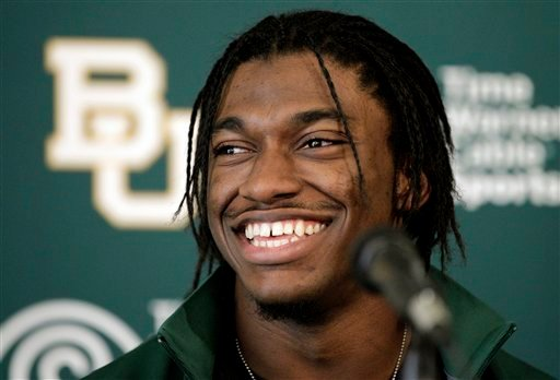 Heisman Trophy winner Robert Griffin III smiles after announcing that he will skip his senior season at Baylor to enter the NFL draft during a news conference, Wednesday, Jan. 11, 2012, in Waco, Texas. (AP Photo/Tony Gutierrez)