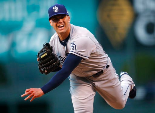 San Diego Padres starting pitcher Clayton Richard delivers a pitch to Colorado Rockies' Charlie Blackmon in the first inning of a baseball game Monday, April 9, 2018, in Denver. (AP Photo/David Zalubowski)
