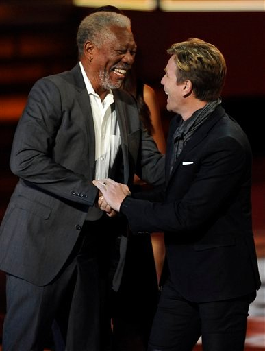Morgan Freeman accepts the award for favorite movie icon from Ewan McGregor during the People's Choice Awards on Wednesday, Jan. 11, 2012 in Los Angeles. (AP Photo/Chris Pizzello)