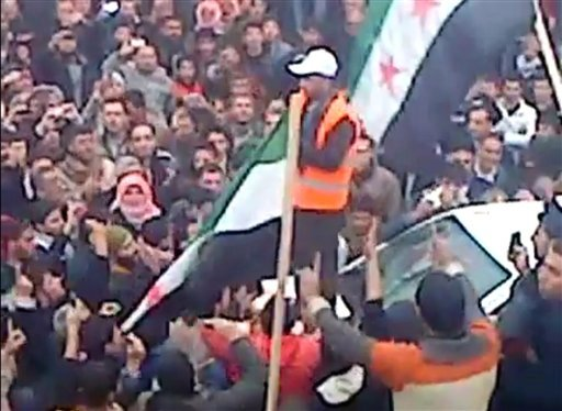 This image made from amateur video and made available by Shaam News Network Wednesday, Jan. 11, 2012, purports to show protesters gathered as Arab League observers visit al-Hasaka, Syria. (AP Photo/Shaam News Network via APTN)