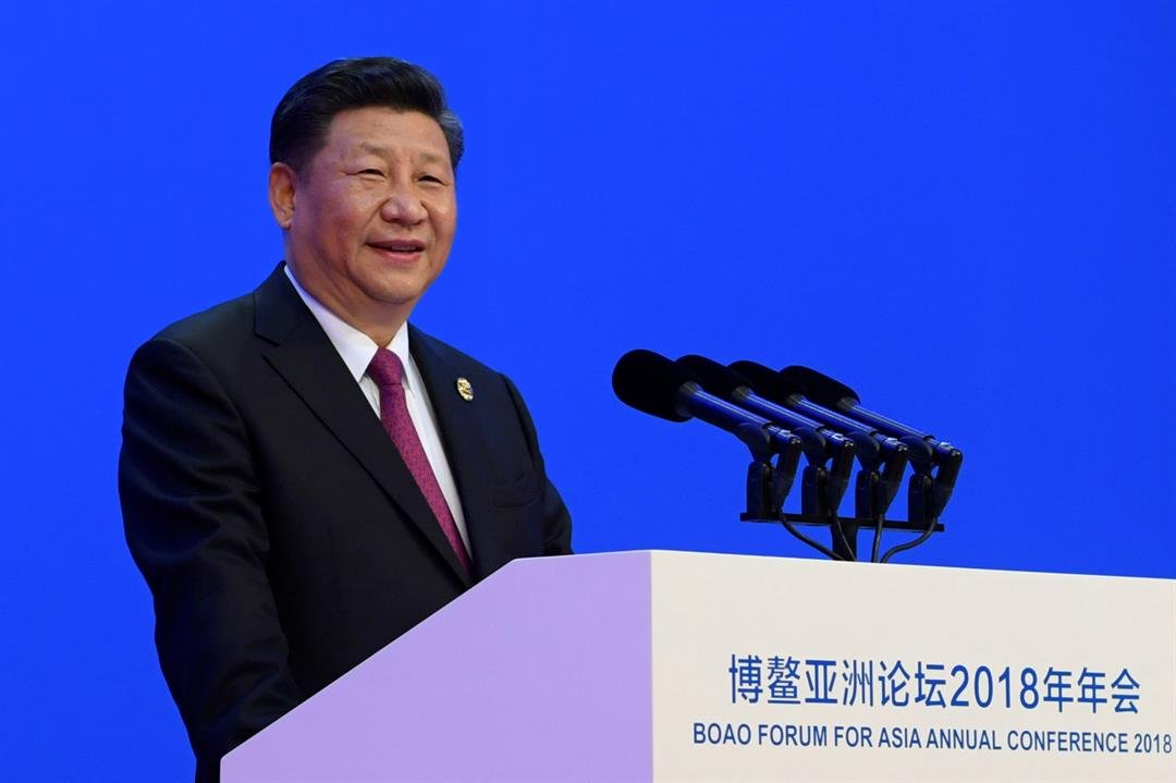 Chinese President Xi Jinping delivers his opening speech at the Boao Forum for Asia Annual Conference. Xi promised to cut auto import taxes, open China's markets further and improve conditions for foreign companies. (Li Xueren/Xinhua via AP)