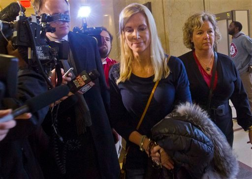 Beth Holloway, second from right, is pursued by reporters following a hearing in Birmingham, Ala.,Thursday, Jan. 12, 2012. (AP Photo/Dave Martin)