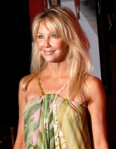 FILE - In this June 12, 2009 file photo, Heather Locklear arrives at the Women in Film Crystal Lucy Awards in Los Angeles. Paramedics responded to Locklear's home 35 miles northwest of Los Angeles .