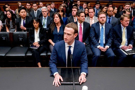 Facebook CEO Mark Zuckerberg arrives to testify before a House Energy and Commerce hearing on Capitol Hill in Washington, Wednesday, April 11, 2018.