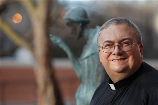 In this Wednesday, Jan. 11, 2012 photo, Rev. Patrick Lagges stands in front of a statue of Saint Francis in Chicago. Lagges, a canon lawyer for three decades in the Catholic Church, helped lead the canon law society workshop last year. (AP)