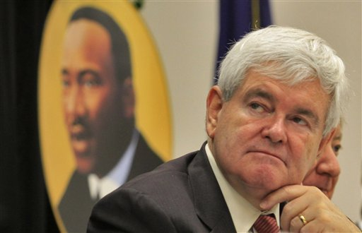 Presidential candidate Newt Gingrich, listens to speakers at the Martin Luther King Jr. celebration breakfast Monday, Jan. 16, 2012 at the Canal Street Recreation Center in Myrtle Beach. (AP Photo/The Sun News, Steve Jessmore)