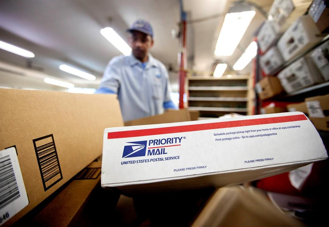 FILE - In this file photo, packages wait to be sorted in a Post Office. After weeks of railing against online shopping giant Amazon, President Trump signed an executive order, creating a task force to study the U.S. Postal System. (AP Photo/David Goldman)