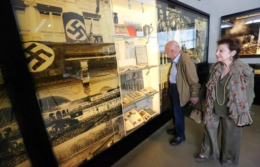 In this Wednesday, April 11, 2018, photo, childhood Holocaust survivors Simon Gronowski and Alice Gerstel Weit tour the Los Angeles Holocaust Museum after their reunion after more than 70 years. (AP Photo/Reed Saxon)