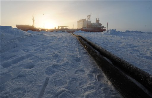 In a photo provided by the U.S. Coast Guard, two fuel transfer hoses run side-by-side from the Russian tanker Renda to the Nome harbor Jan. 16, 2012. (AP Photo/U.S. Coast Guard, Petty Officer 3rd Class Grant DeVuyst)