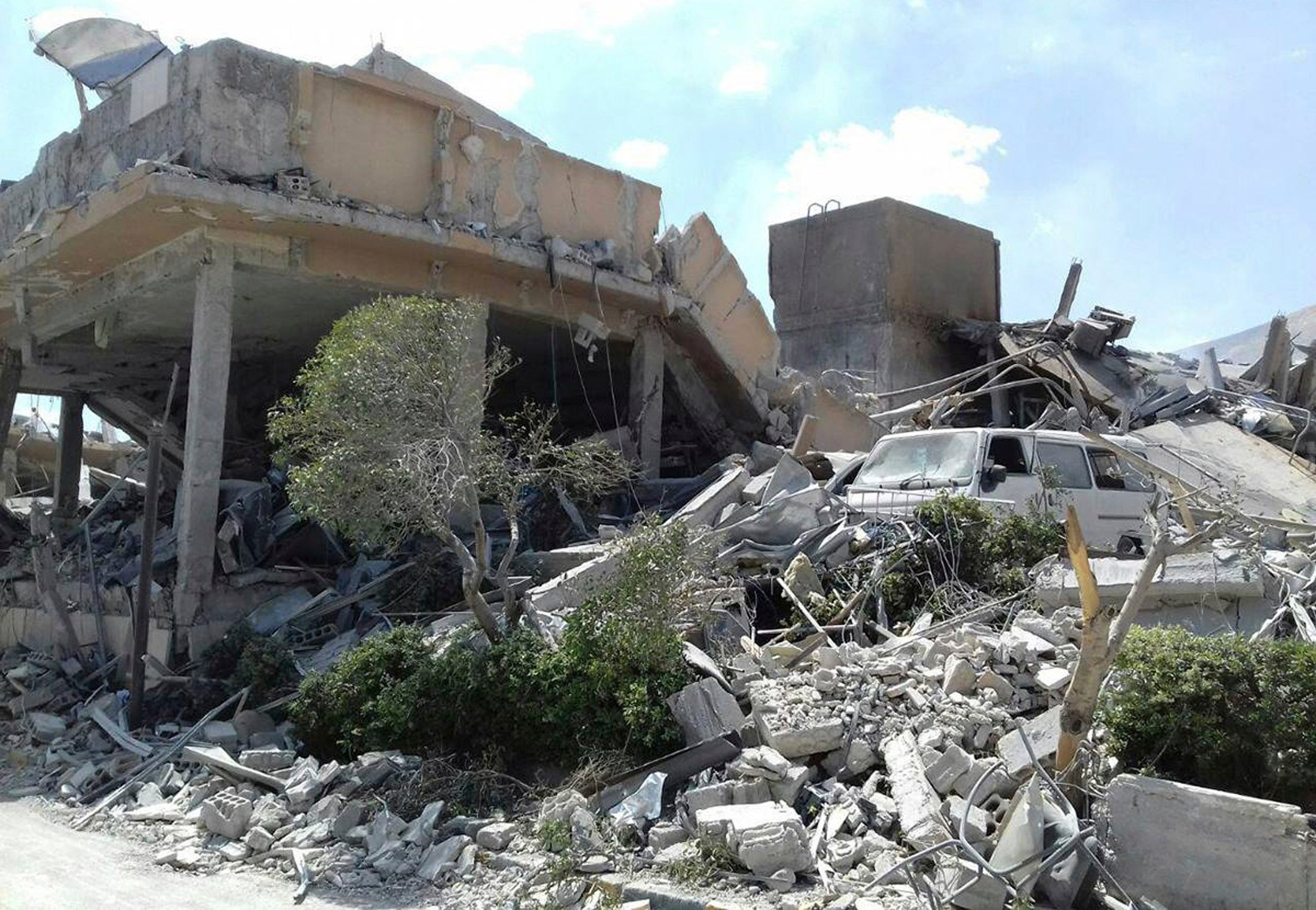 In this photo released by the Syrian news agency SANA, shows the damage of the Syrian Scientific Research Center which was attacked by U.S., British and French military strikes to punish President Bashar Assad for suspected chemical attacks. (SANA via AP)