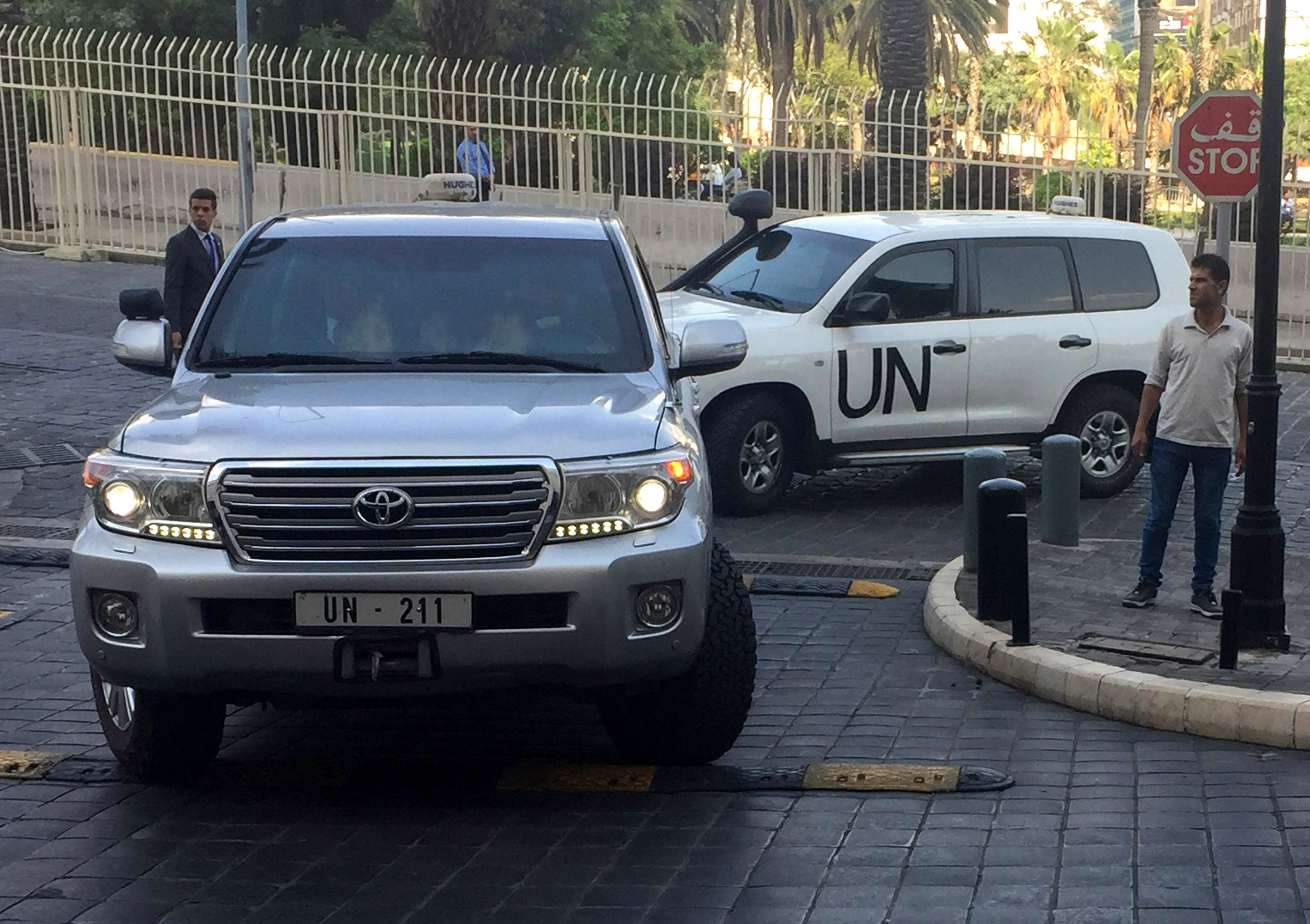 United Nations vehicles carry the team of the Organization for the Prohibition of Chemical Weapons (OPCW), arrive at hotel hours after the U.S., France and Britian launched an attack on Syrian facilities. (AP Photo/Bassem Mroue)