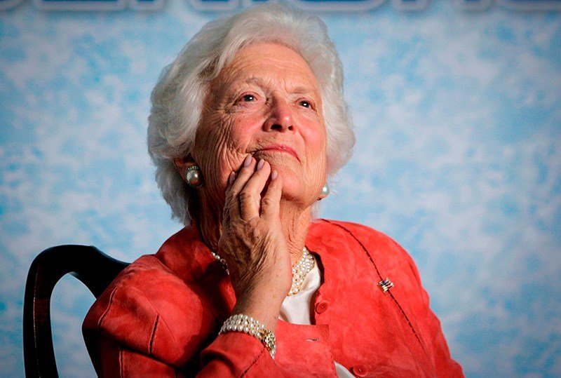 In this file photo from Friday, March 18, 2005, former first lady Barbara Bush listens to her son, President George W. Bush, as he speaks on Social Security reform in Orlando, Fla. (AP Photo/J. Scott Applewhite, file)