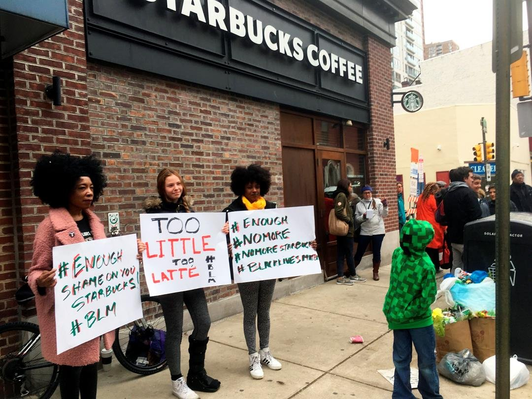 Protesters gather outside a Starbucks in Philadelphia, Sunday, April 15, 2018.