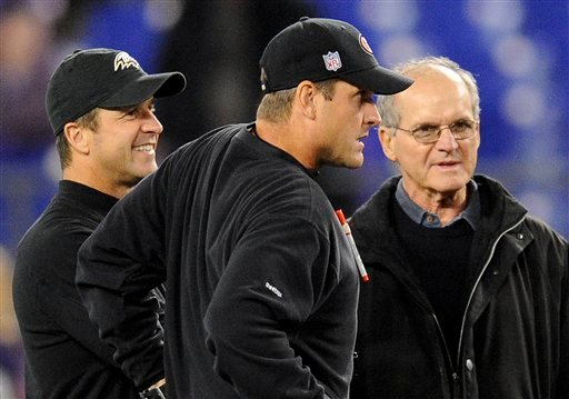 FILE - In this Nov. 24, 2011 file photo, Baltimore Ravens head coach John Harbaugh, left, chats with his brother, San Francisco 49ers head coach Jim Harbaugh, center, and their father, Jack, before their NFL football game in Baltimore.