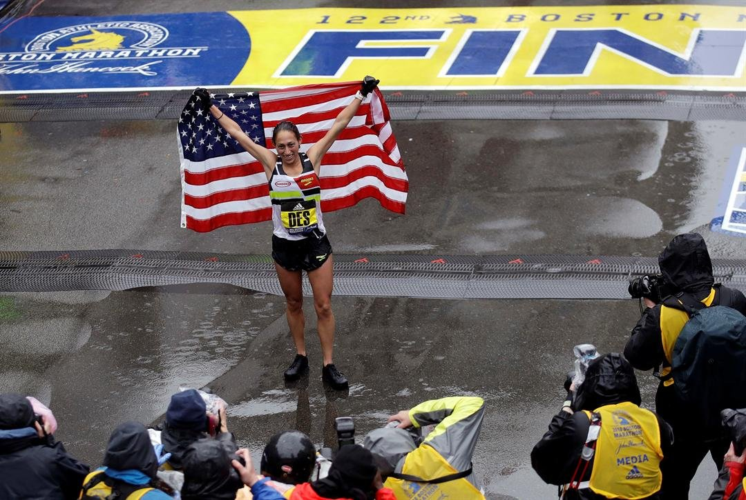 Desiree Linden, of Washington, Mich., celebrates after winning the women's division of the 122nd Boston Marathon on Monday, April 16, 2018, in Boston. (AP Photo/Charles Krupa.)