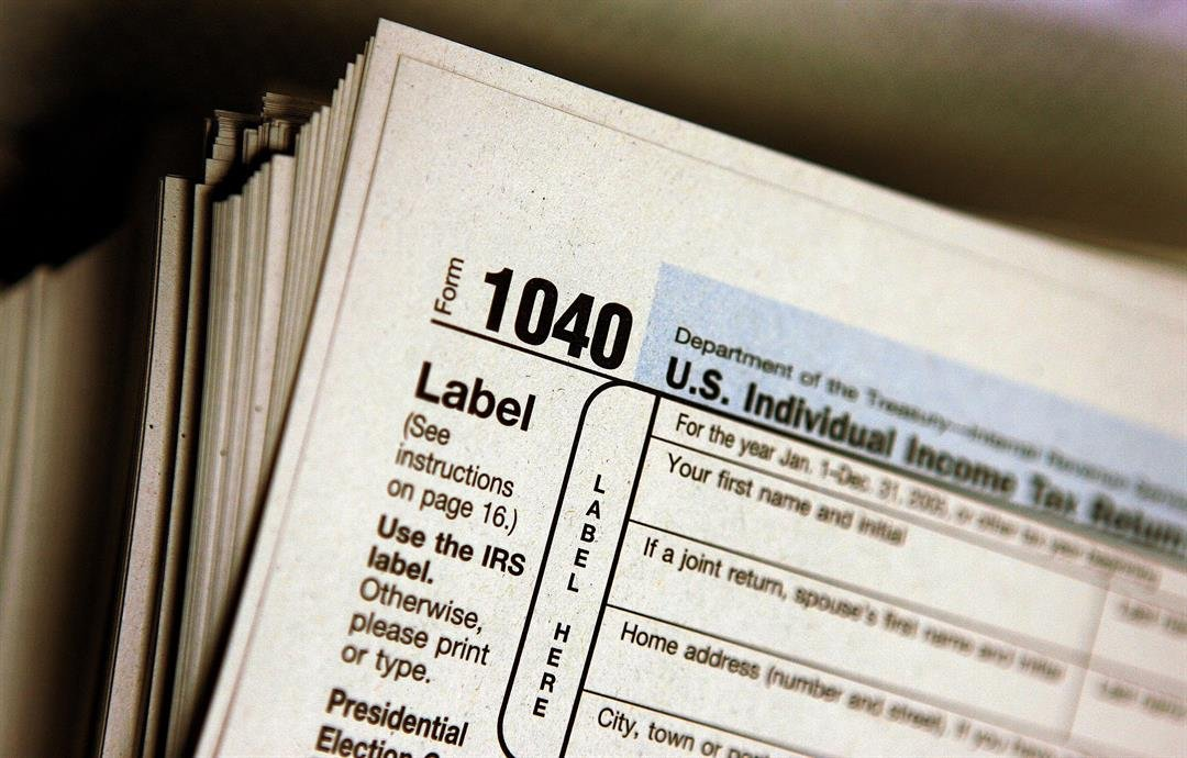 The top of a form 1040 individual income tax return for 2005 is seen atop a stack on the same at the Des Plaines Public Library March 23, 2006 in Des Plaines, Illinois.