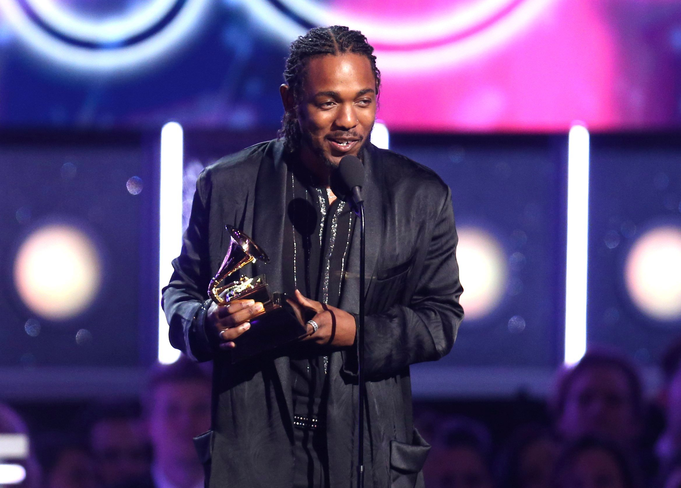 "Kendrick Lamar accepts the award for best rap album for ""Damn"" at the 60th annual Grammy Awards at Madison Square Garden on Sunday, Jan. 28, 2018, in New York. (Photo by Matt Sayles/Invision/AP)"