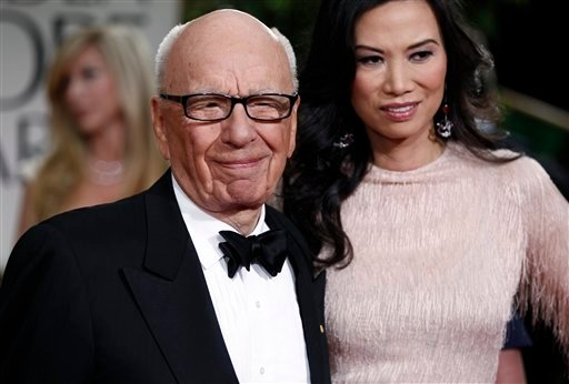 Rupert Murdoch and his wife Wendi arrive at the 69th Annual Golden Globe Awards Sunday, Jan. 15, 2012, in Los Angeles. (AP Photo/Matt Sayles)
