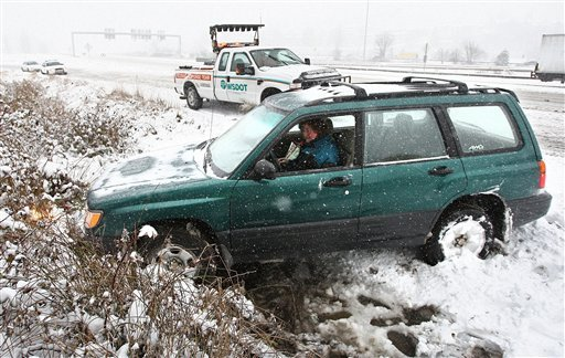 Heather Wilson ran into a rough spot on an onramp to I-5 south near exit 154A in Tukwila, Wash. on Wednesday, January 18, 2012. (AP Photo/The Seattle Times, John Lok)
