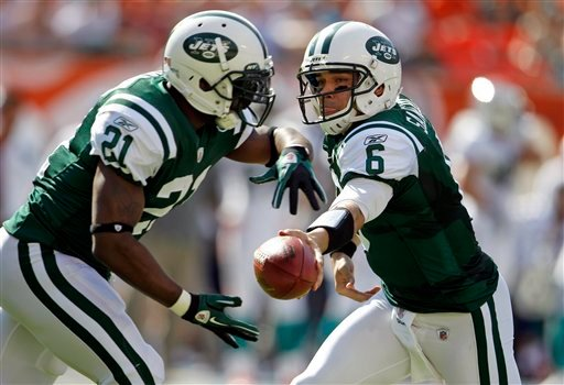 New York Jets quarterback Mark Sanchez (6) hands the ball to running back LaDainian Tomlinson (21) during the first half of an NFL football game against the Miami Dolphins, Sunday, Jan. 1, 2012, in Miami. (AP Photo/Lynne Sladky)