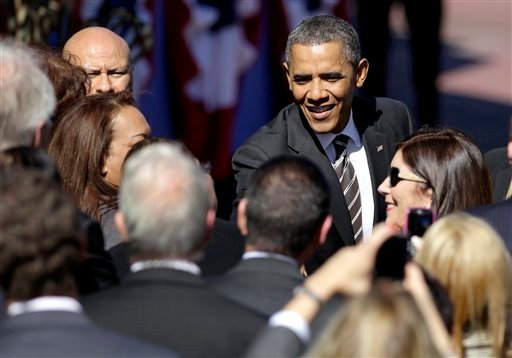 President Barack Obama greets guests after speaking at the Magic Kingdom Park at Walt Disney World, Thursday, Jan. 19, 2012, in Lake Buena Vista, Fla. (AP Photo/John Raoux)