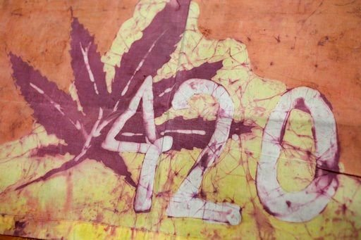 This Friday, April 13, 2018, photo, shows a Waldos 420 flag from 1972 made by a classmate at San Rafael High School, at a bank vault in San Francisco.