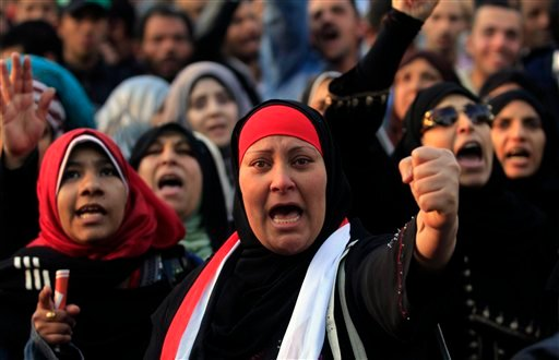 Protesters chant slogans at a rally honoring those killed in clashes with security forces in Tahrir Square in Cairo, Egypt, Friday, Jan. 20, 2012, nearly a year after the 18-day uprising that ousted President Hosni Mubarak. (AP)