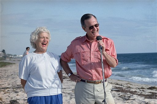 President-elect George Bush and his wife Barbara are shown during a morning beachfront news conference in Gulf Stream, Fla., Nov. 14, 1988. Bush is expected to return to Washington Tuesday after a long weekend vacationing in Florida. (AP Photo/Kathy Wille