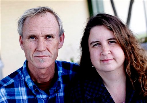 In this photo taken Wednesday, Jan. 18, 2012, Dan and Vicki McCuistion, of Driftwood, Texas, pose for a photo together in Austin, Texas. (AP)