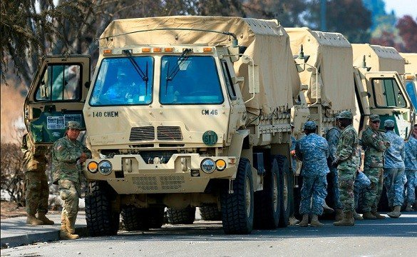This Oct. 16, 2017, photo shows the California National Guard deployed near Santa Rosa, Calif. Kent Porter/The Press Democrat via AP
