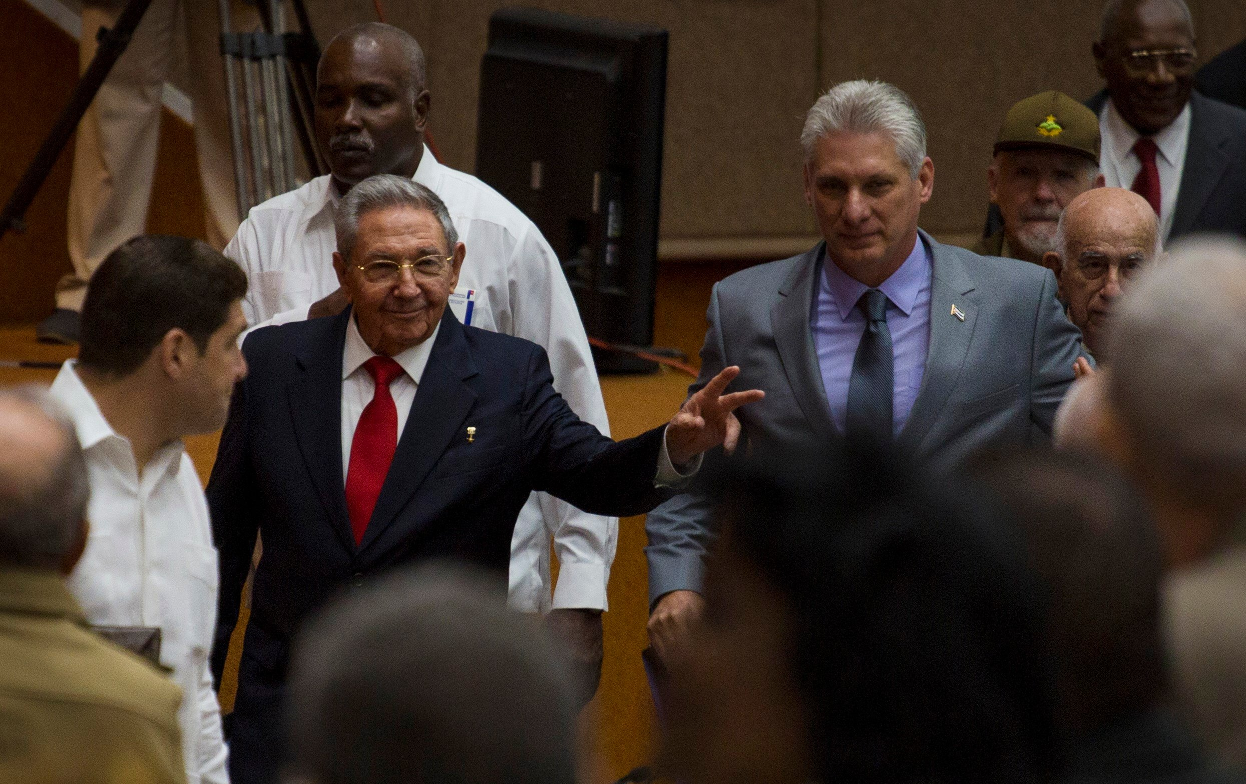 In this photo released by Cuba's state-run media Cubadebate, Cuba's President Raul Castro, center left, enters the National Assembly followed by his successor Miguel Diaz-Canel, center right. (Irene Perez/Cubadebate via AP)