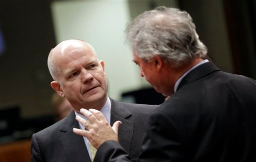 British Foreign Minister William Hague, left, speaks with Luxembourg's Foreign Minister Jean Asselborn during a meeting of EU foreign ministers at the EU Council building in Brussels on Monday, Jan. 23, 2012. (AP)