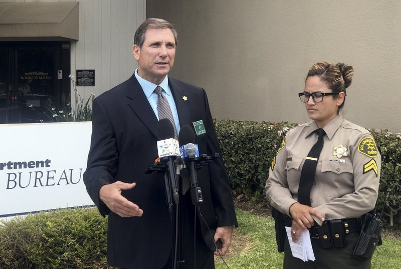 Los Angeles County sheriff's Lt. John Corina, left, speaks next to Deputy Joana Warren outside of the sheriff's homicide bureau office in Monterey Park, Calif., Thursday, April 19, 2018.