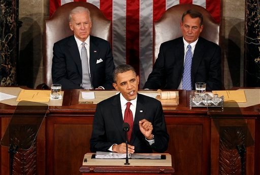 President Barack Obama gestures while giving his State of the Union address on Capitol Hill in Washington, Tuesday, Jan. 24, 2012. Vice President Joe Biden and House Speaker John Boehner of Ohio listen at rear. (AP Photo/J. Scott Applewhite)